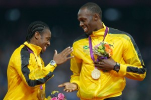 Usain Bolt (right) and Yohan Blake on the podium London 2012
